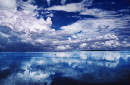 metal photo print with beautiful blue sky with clouds reflected on water