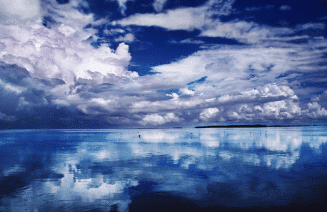 Beautiful blue sky with clouds, reflected on water, printed on metal
