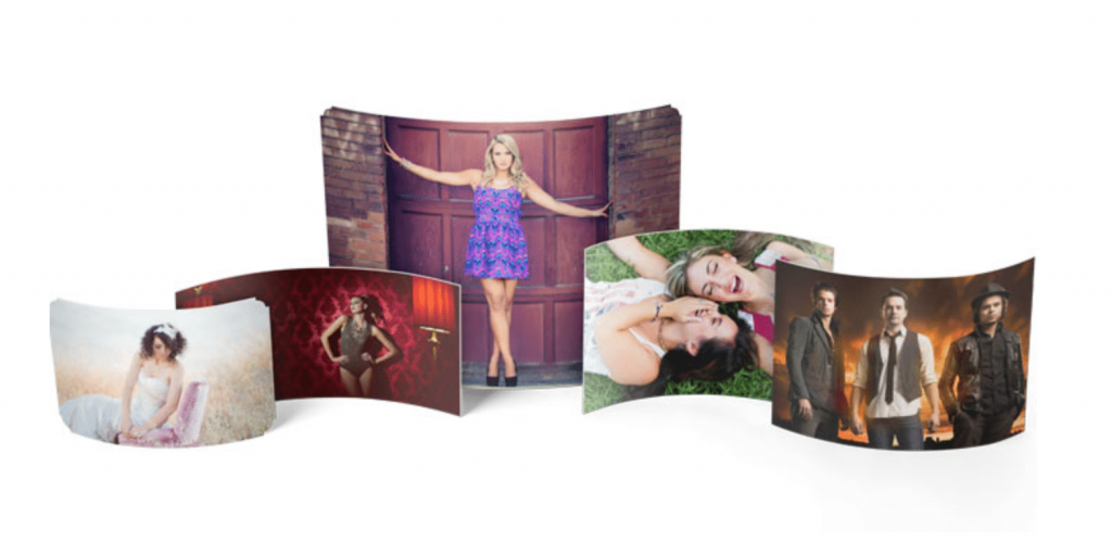 assortment of curved metal prints with different images and sizes